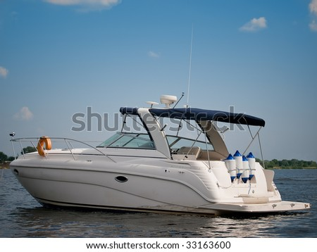 Luxury boat on river against a blue sky