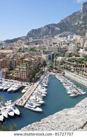 Luxury boats in Monaco Harbor. View from Monte Carlo. French riviera. Blue Coast. Mediterranean Sea. - stock photo