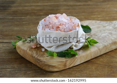 Luxury brand pink salt in a linen bag - stock photo