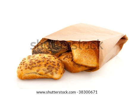 Luxury bread rolls in bag with grain isolated over white - stock photo