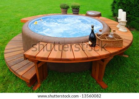 Luxury bubble bath in a green garden - stock photo