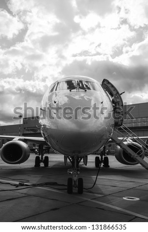 Luxury Business Private Jet plane at airfield black white