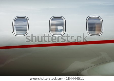Luxury Business Private Jet plane windows raw - stock photo