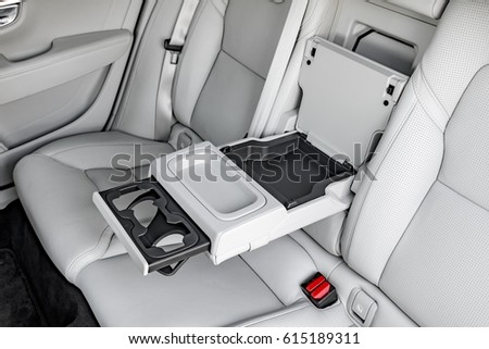 Luxury car central armrest for rear seat passengers
