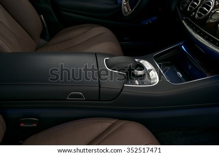 Luxury car interior background. Dashboard control buttons. - stock photo