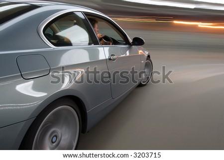 Luxury Car on the Move - stock photo