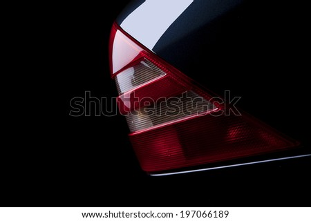 Luxury Car Rear Tail Light close up on black background - stock photo