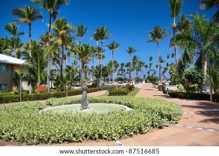 Luxury caribbean hotel resort, road to ocean - stock photo