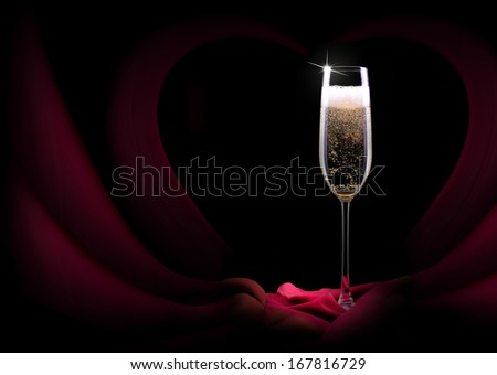 luxury champagne glass with a red silk - stock photo