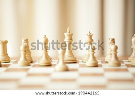 luxury chessboard and chess pieces - stock photo