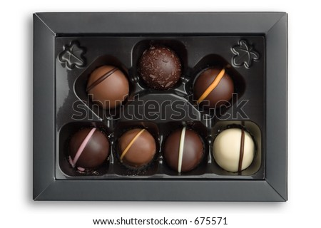 Luxury chocolates in a box, isolated against white background with clipping path - stock photo