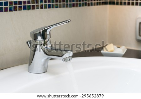 Luxury Chrome faucet with washbasin in modern bathroom