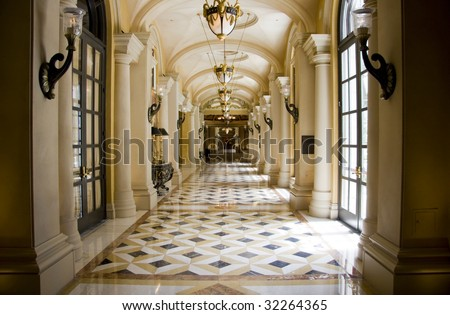 Luxury classic colonnade corridor with marble floor and row of lusters - stock photo