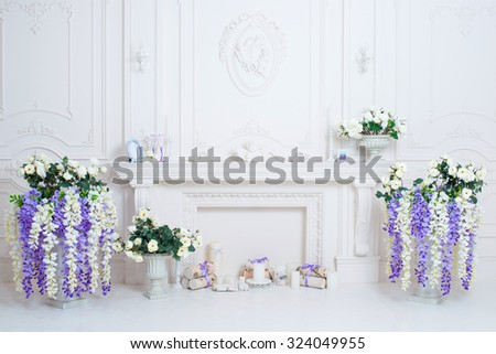 Luxury clean bright interior with white fireplace - stock photo