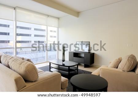 Luxury Condominium Apartment Living Space with large glass windows - stock photo