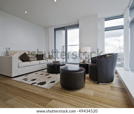 luxury contemporary city apartment with floor to ceiling windows - stock photo
