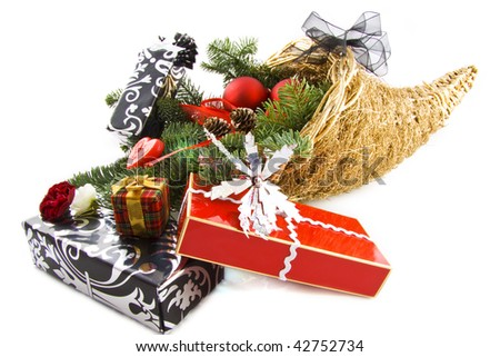 Luxury cornucopia filled with decorative presents isolated over white - stock photo