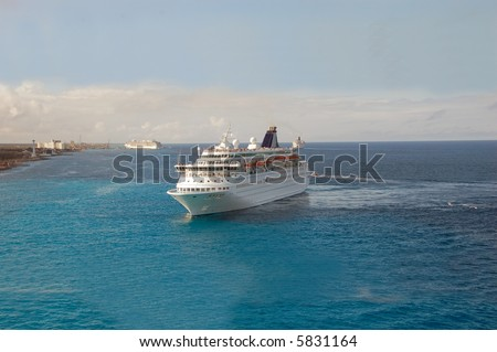 Luxury cruise liner approaching exotic port