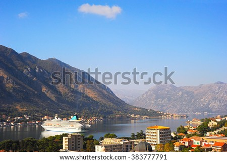 Luxury cruise liner in Kotor bay at sunset. Montenegro - stock photo