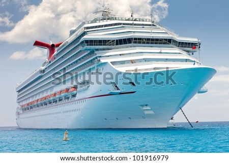 Luxury cruise ship anchored near the island of Grand Cayman, Cayman Islands, in the Eastern Caribbean. - stock photo