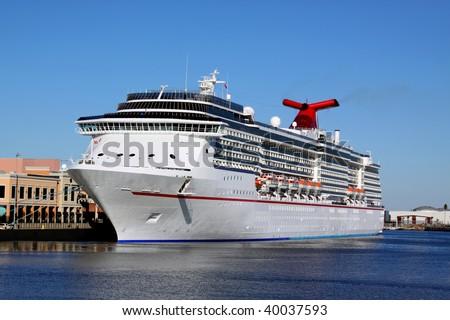 Luxury Cruise Ship docking in Tampa Bay, Florida, fun starts here. - stock photo