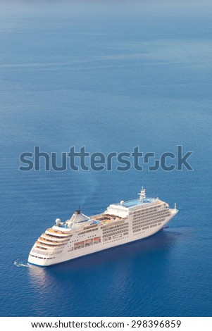 Luxury cruise ship sailing around Santorini island, Aegean sea in Greece. - stock photo