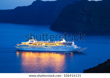 Luxury Cruise Ship Sailing at Sunset - stock photo