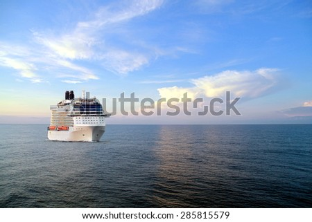 Luxury cruise ship sailing to port on sunrise  - stock photo