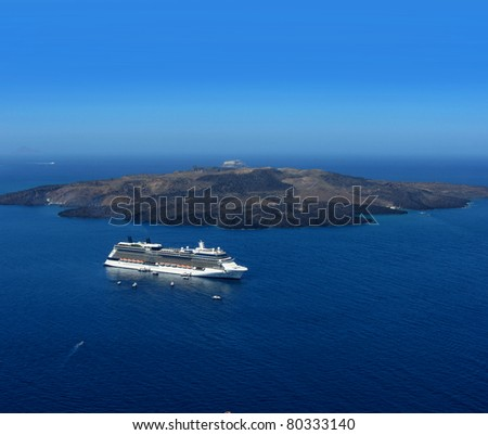 Luxury cruiser in blue Santorini volcano caldera - stock photo