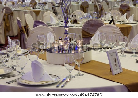 luxury decorated tables in the wedding hall