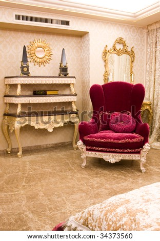 Luxury decoration of living room with big pink armchair