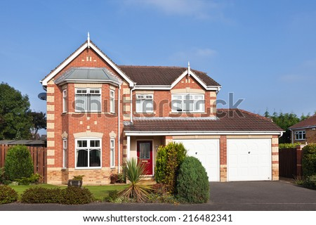 Luxury detached house with double garage - stock photo