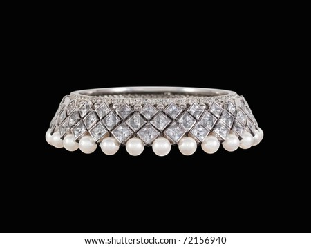 Luxury diamonds and pearls bracelet - stock photo