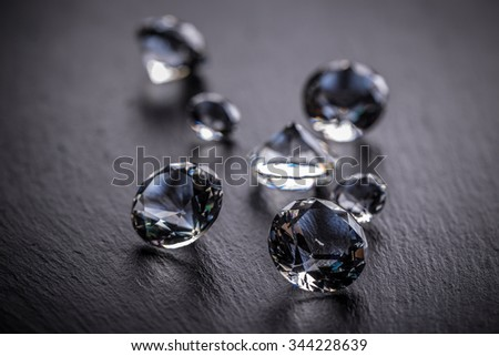 Luxury diamonds on black background - stock photo