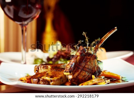 luxury dinner served on  the table with glass of red wine - stock photo