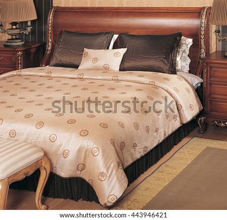 Luxury double bed and elegant brown cream bedspread - stock photo