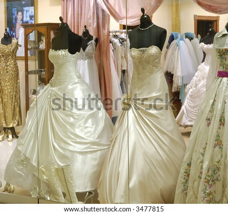 luxury dresses in boutique - stock photo