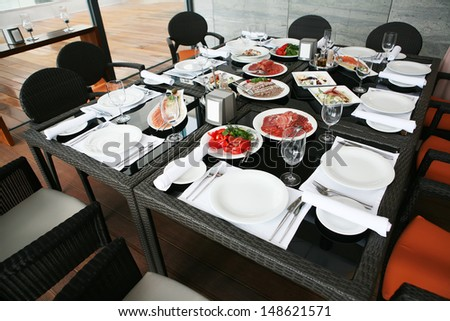 luxury drinks and food on a festive table - stock photo