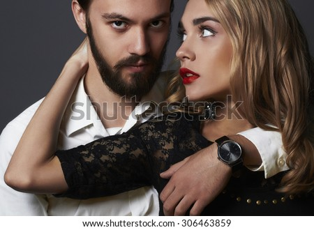 luxury elegant couple in the tender passion. Beautiful woman near the man.beautiful girl and boy together - stock photo