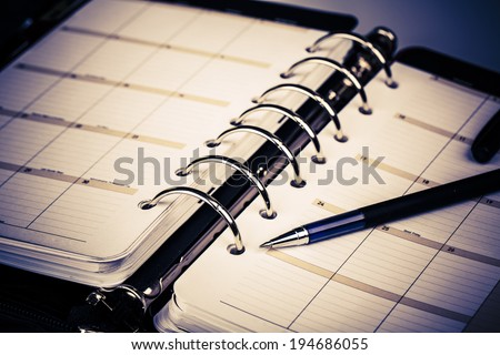 luxury executive leather personal organizer or planner on white background  - stock photo