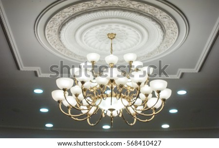 luxury expensive chandelier hanging under ceiling stock photo