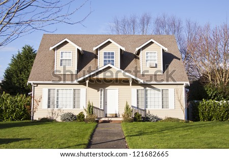 luxury family house with landscaping on the front and blue sky on background - stock photo