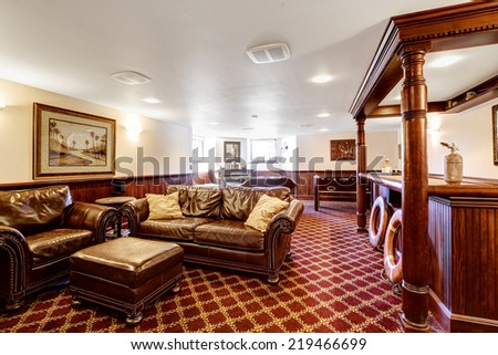 Superb Luxury Family Room With Bar And Rich Leather Furniture Set. Bright Red  Carpet Floor