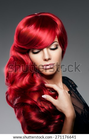 Luxury fashion trendy  young  woman with red curled hair. Girl with beauty hairstyle. Model with long stylish  bangs, wave, curly hair. Lady with a beauty face - stock photo