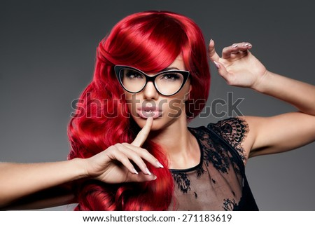 Luxury fashion trendy  young  woman with red curled hair in glasses. Optics. Girl with beauty hairstyle. Model with long stylish  bangs, wave, curly hair. Lady with a beauty face. Secret, gossip, news - stock photo