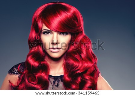 Luxury fashion trendy  young  woman with red curled hair. Woman with beauty hairstyle. Model with long stylish  bangs, wave, curly hair. Lady with a beauty face