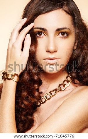 Luxury fashion woman with glamour gold accessories, curly hairstyle - stock photo