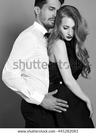 luxury fashionable couple in tender passion. Beautiful woman near the man.beauty girl and boy together.black and white portrait - stock photo