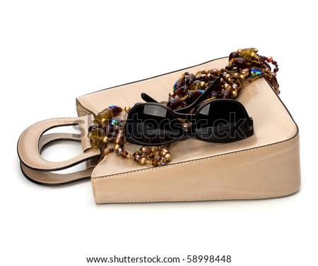 Luxury female handbag isolated on white background - stock photo