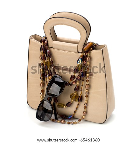 Luxury female handbag isolated on white background
